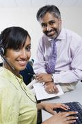 Happy Call Center Employees Working Together - stock photo