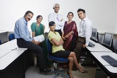 Happy Call Center Employees Smiling Together - stock photo