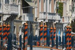 Bricole and poles to anchor the gondola on the grand canal in venice Stock Photos