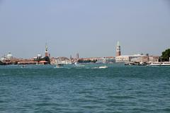 Skyline of venice with steeples, boat and ferry in the adriatic sea Stock Photos
