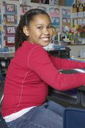 Preadolescent Girl Sitting In The Classroom Stock Photos