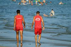 Lifeguards on the beach while patrolling the coast in search of people who dr Stock Photos
