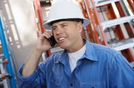 Stock Photo of Industrial Worker Using Cell Phone