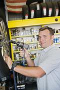 Mechanic Holding Electronic Screw Fitter - stock photo