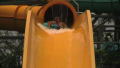 People Going Down Waterslide Drop on a Tube Stock Footage