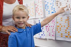 Little Boy Pointing To A Calendar Date For Teacher - stock photo