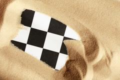 chess in sand - stock photo