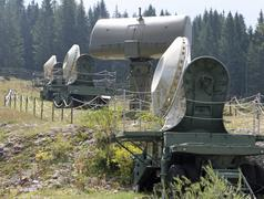 Four camouflaged radar in a secret army military base Stock Photos