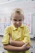 Angry Little Boy In Classroom - stock photo