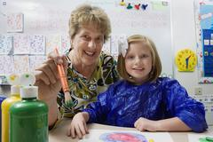Teacher And Student Painting - stock photo