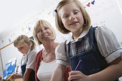 Teacher And Elementary Students - stock photo