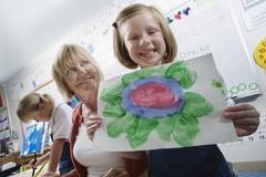 Elementary Student Showing Painting - stock photo