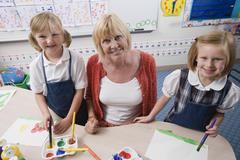 Teacher With Students In Art Class - stock photo