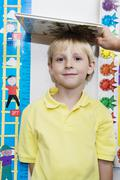 Boy Getting Height Measured By Teacher - stock photo