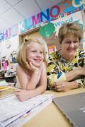 Teacher With Elementary Student - stock photo