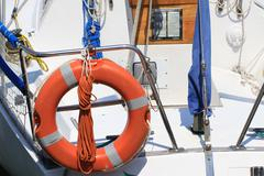 Lifebuoy attached to a boat at the port of venice ready upon departure Stock Photos