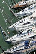 Luxurious and expensive yachts and motor boats moored in the tourist harbour Stock Photos