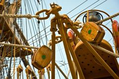 sailboat wooden marine rigs and ropes - stock photo