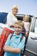 Grandmother Driving Grandchildren To School Stock Photos