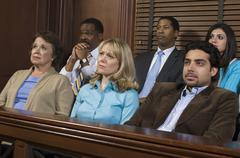 Jurors Sitting In Courtroom During Trial - stock photo