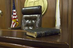 Bible And Chair In Courtroom - stock photo