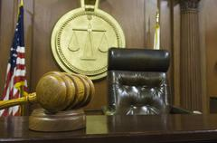 Gavel And Judge's Chair In Courtroom - stock photo