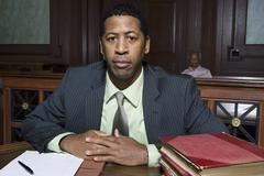 Lawyer Sitting In Courtroom Stock Photos