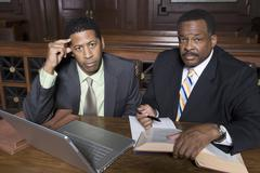 Stock Photo of Businessman And Lawyer Sitting Together