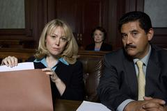 Stock Photo of Lawyers In Courtroom