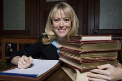 Stock Photo of Female Advocate With Law Books