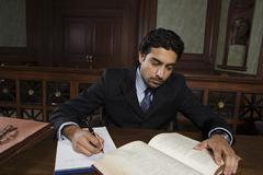 Male Advocate Reading Law Book Stock Photos