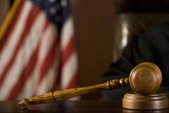 Stock Photo of Gavel Lying In Front Of Judge's Chair