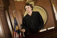 Stock Photo of Female Judge Forming A Judgment