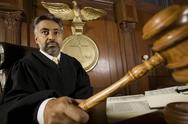Stock Photo of Judge Forming Sentence