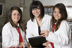 High School Students With Professor In Chemistry Lab - stock photo