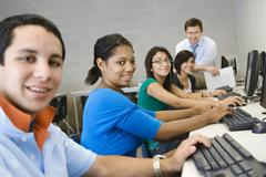 High School Students With Professor In Computer Class - stock photo