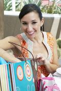 Stock Photo of Woman With Shopping Bag At Restaurant