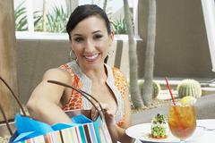 Woman With Shopping Bag Having Refreshments Stock Photos