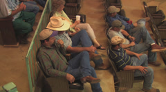 Ranchers watch cattle auction Stock Footage