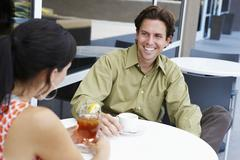 Man Enjoying Coffee Date With Woman - stock photo