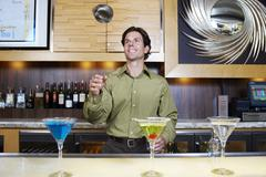 Bartender Tossing Shaker in the Air - stock photo