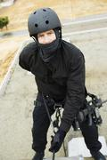 Swat Team Officer Rappelling - stock photo