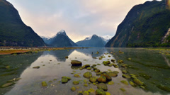 Timelapse of Rising Tide and Moving Clouds at Milford Sound Stock Footage