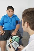 Stock Photo of Boy Having His Blood Pressure Checked