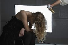 Fashion Model Having Hair Sprayed At Photo Shoot Stock Photos