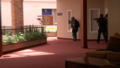 Swat Team searching building - stock footage