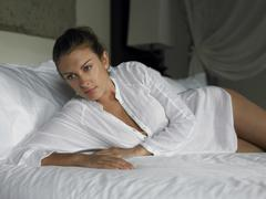Sensuous Woman Lying In Bed - stock photo