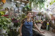Stock Photo of Confident Female Florist In Shop