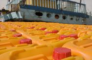 Stock Photo of Dubai UAE Cooking oil waits to be loaded aboard a dhow headed for Iran or