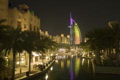Dubai UAE colourfully lit world famous Burj Al Arab hotel Dubai icon - stock photo